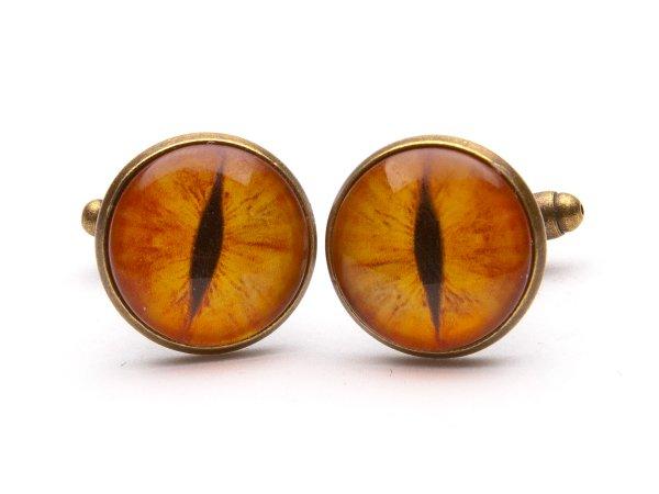 Запонки с оранжевыми глазами